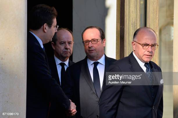 French President Francois Hollande speaks with French Minister of Interior Matthias Fekl after a defense council at Elysee Palace on April 21 2017 in...