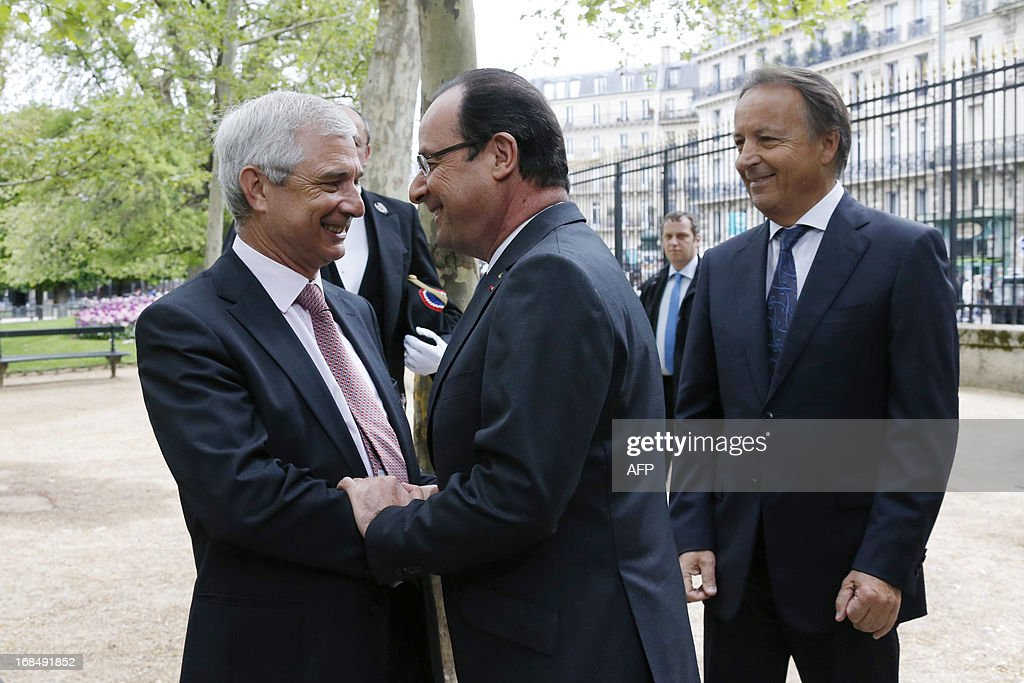 French President Francois Hollande (C) speaks with French National Assembly Speaker Claude Bartolone (L) as Speaker of the French Senate Jean-Pierre Bel looks on as they arrive to attend a ceremony at the Luxembourg Gardens to mark the abolition of slavery and to pay tribute to the victims of the slave trade in Paris May 10, 2013.