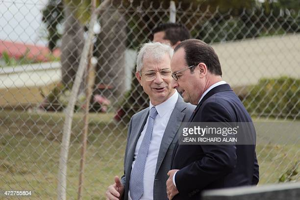 French President Francois Hollande speaks with French National Assembly President Claude Bartolone after laying a wreath on the grave of Francophone...
