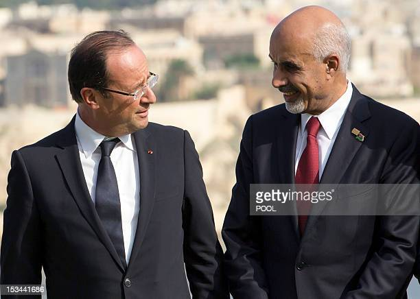 French President Francois Hollande speaks with Mohamed Yousef ElMagariaf President of the General National Congress of Libya during the group photo...