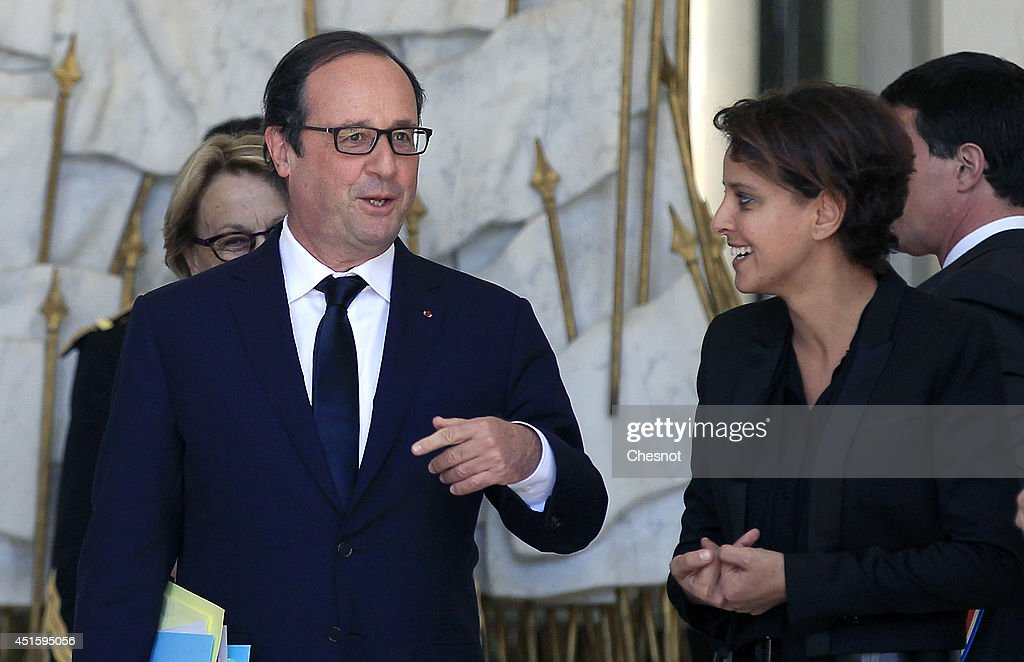 French President, Francois Hollande speaks with <a gi-track='captionPersonalityLinkClicked' href=/galleries/search?phrase=Najat+Vallaud-Belkacem&family=editorial&specificpeople=4115928 ng-click='$event.stopPropagation()'>Najat Vallaud-Belkacem</a>, French Minister of Women's Rights, the City, Youth and Sports after a weekly cabinet meeting at the Elysee Palace on July 2, 2014 in Paris, France.
