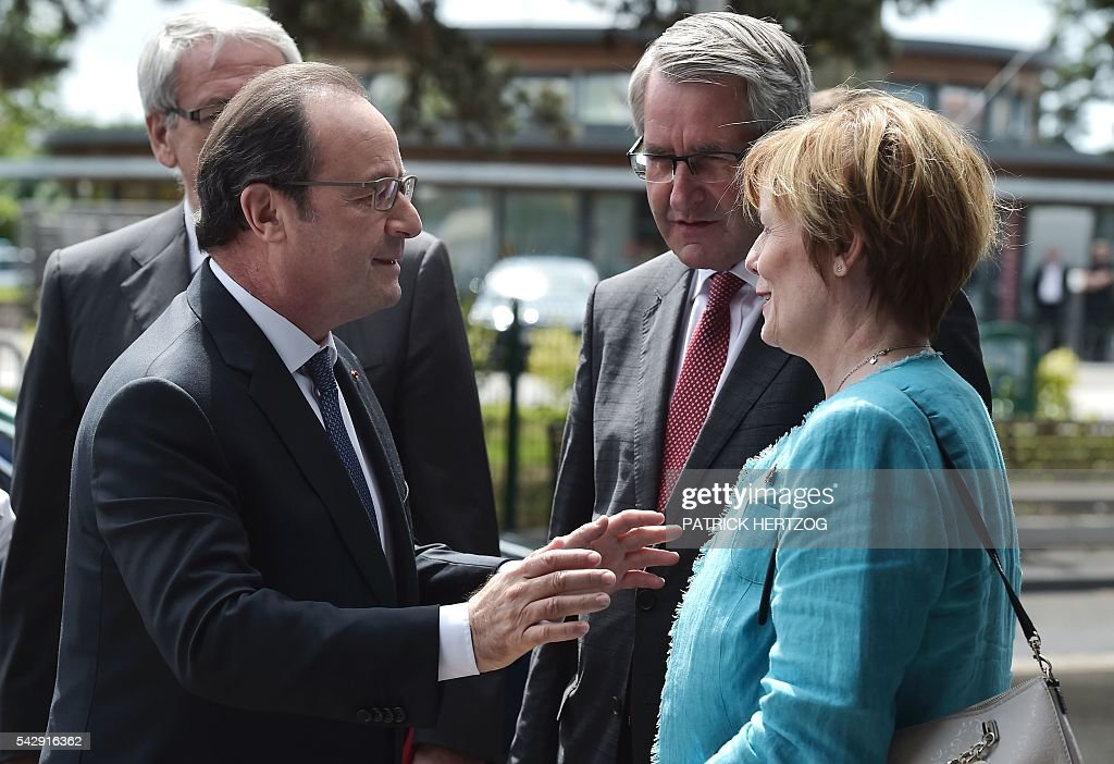 French President Francois Hollande (L) speaks with President of the French Region Grand-Est Philippe Richert (C) and senator Patricia Schillinger (R) as he arrives to attend the general assembly of the National Union of Family Associations (Union Nationale des Associations Familiales, UNAF) on June 25, 2016 in Colmar, eastern France. / AFP / PATRICK