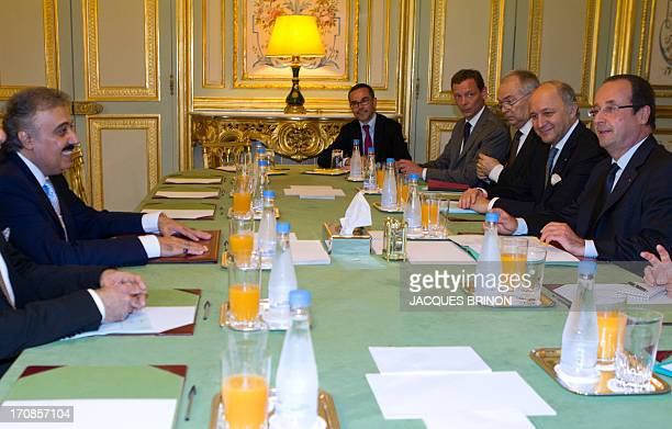 French President Francois Hollande speaks with Saudi Prince Mutaib bin Abdullah al Saud during their meeting at the Elysee Presidential Palace on...