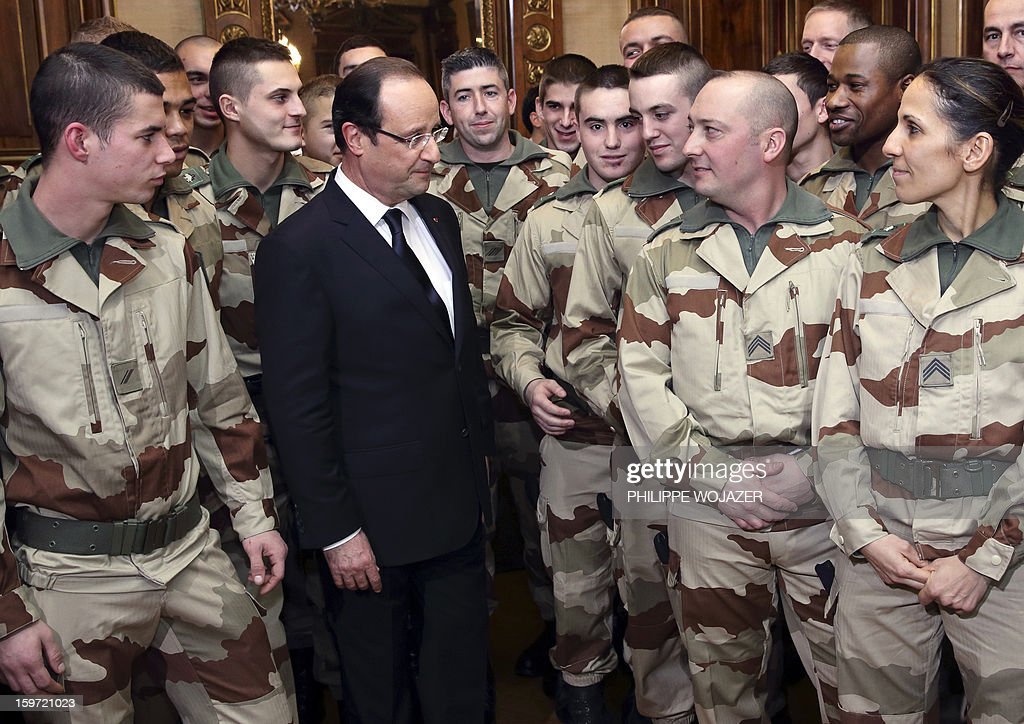 French President Francois Hollande speaks with soldiers of the 126 RI (Infantry Regiment) who are due to leave for Mali, during a meeting in Tulle, central France, on January 19, 2013.