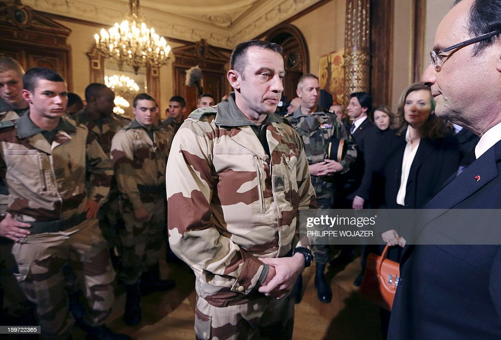 French President Francois Hollande (R) speaks with soldiers of the 126 RI (Infantry Regiment) who are due to leave for Mali, during a meeting in Tulle, central France, on January 19, 2013. At second right is seen the partner of French President Francois Hollande, Valery Trierweiler.