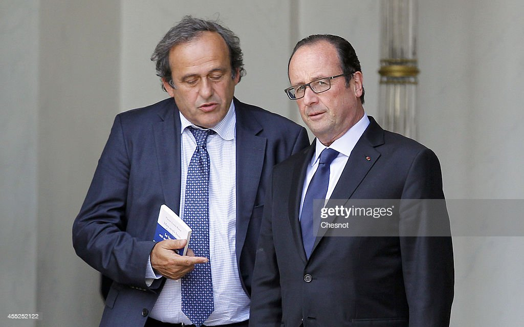 French President Francois Hollande speaks with UEFA President <a gi-track='captionPersonalityLinkClicked' href=/galleries/search?phrase=Michel+Platini&family=editorial&specificpeople=206862 ng-click='$event.stopPropagation()'>Michel Platini</a> (L) after a lunch for the UEFA EURO 2016 launch at the Elysee Palace on September 11, 2014, in Paris, France. The UEFA EURO 2016 will be the 15th European Soccer Championship taking place in France from 10 June to 10 July 2016.
