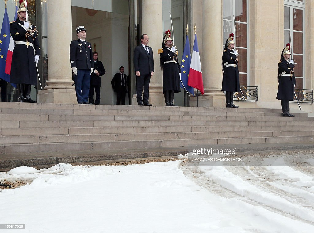 French President Francois Hollande stands at the presidential Elysee Palace after a meeting with Tanzanian President on January 21, 2013 in Paris.