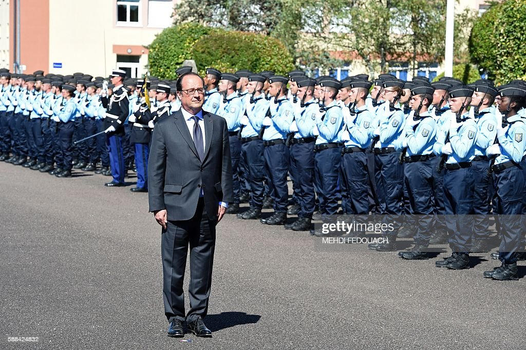 French President Francois Hollande stands next to french young operational reservists during a visit at the French Gendarmerie school in Tulle...