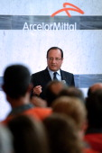 French President Francois Hollande talks to ArcelorMittal employees during a visit at the main steel factory on September 26 2013 in Florange eastern...