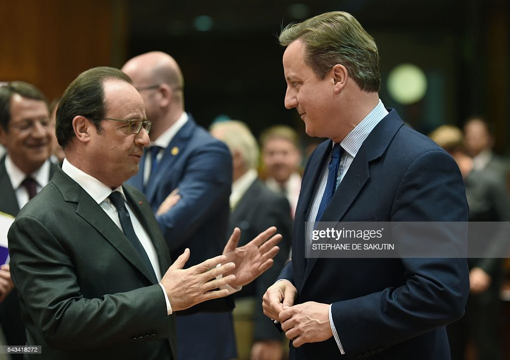 French President Francois Hollande (L) talks with Britain's Prime minister David Cameron during an EU summit meeting on June 28, 2016 at the European Union headquarters in Brussels. Prime Minister David Cameron said Tuesday he wants the 'closest possible' relations with the EU after Britain voted to leave the bloc, adding the split should be 'as constructive as possible'. As he arrived at a Brussels summit, Cameron, who is to step down within weeks, told reporters that, while Britain was leaving the EU, 'we mustn't be turning our backs on Europe.' SAKUTIN