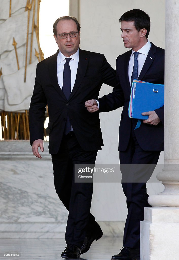 French President Francois Hollande talks with French Prime Minister <a gi-track='captionPersonalityLinkClicked' href=/galleries/search?phrase=Manuel+Valls&family=editorial&specificpeople=2178864 ng-click='$event.stopPropagation()'>Manuel Valls</a> (R) after the weekly cabinet meeting at the Elysee Palace on February 10, 2016 in Paris, France. This is the last cabinet meeting before the next ministerial reshuffle.
