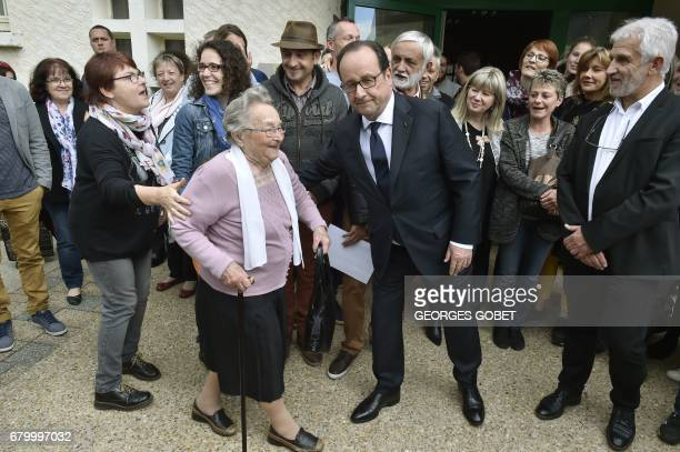 French President Francois Hollande talks with inhabitants in the village of Saint Hilaire on May 7 near Tulle during the second round of the French...