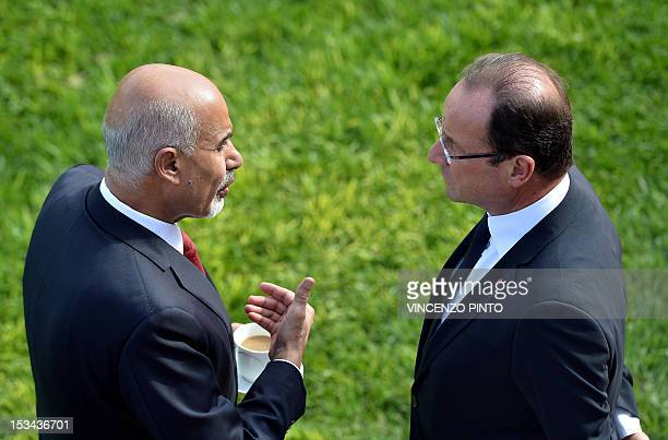 French President Francois Hollande talks with Libyan President Mohamed Magariaf at the Upper Barracca Gardens in Valletta on October 5 2012 as part...
