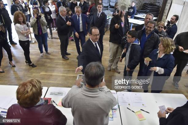 French President Francois Hollande talks with people as he visits a polling station in the village of Saint Mexant near Tulle on May 7 during the...
