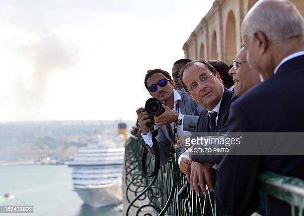 French President Francois Hollande Tunisian President Moncef Marzouki and Libyan President Mohamed Magariaf talk as they look at the Valletta harbor...