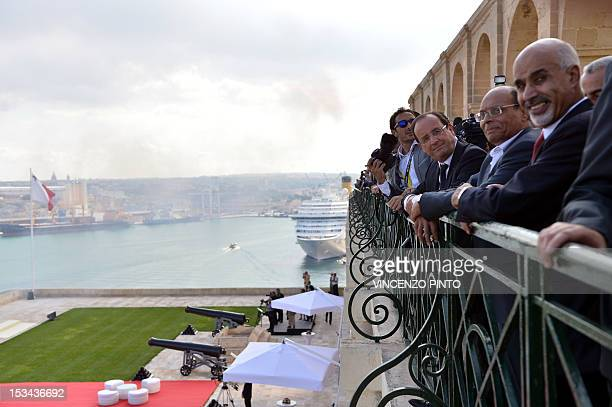 French President Francois Hollande Tunisian President Moncef Marzouki and Libyan President Mohamed Magariaf look at the Valletta harbor prior to...