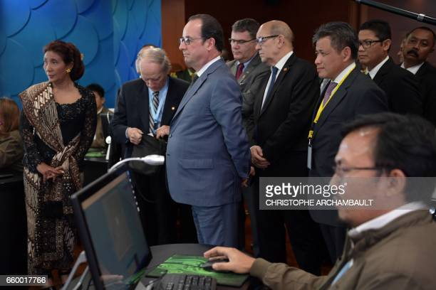 French President Francois Hollande visits a command room of the general direction of the marine surveillance in Jakarta on March 29 2017 Hollande is...