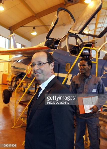 French President Francois Hollande visits Aerocampus manufacture in Latresne near Bordeaux southwestern France on January 10 2013 Hollande was in the...