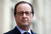 French President Francois Hollande visits an exhibition during a ceremony marking the first anniversary of the energy transition law at the Elysee...