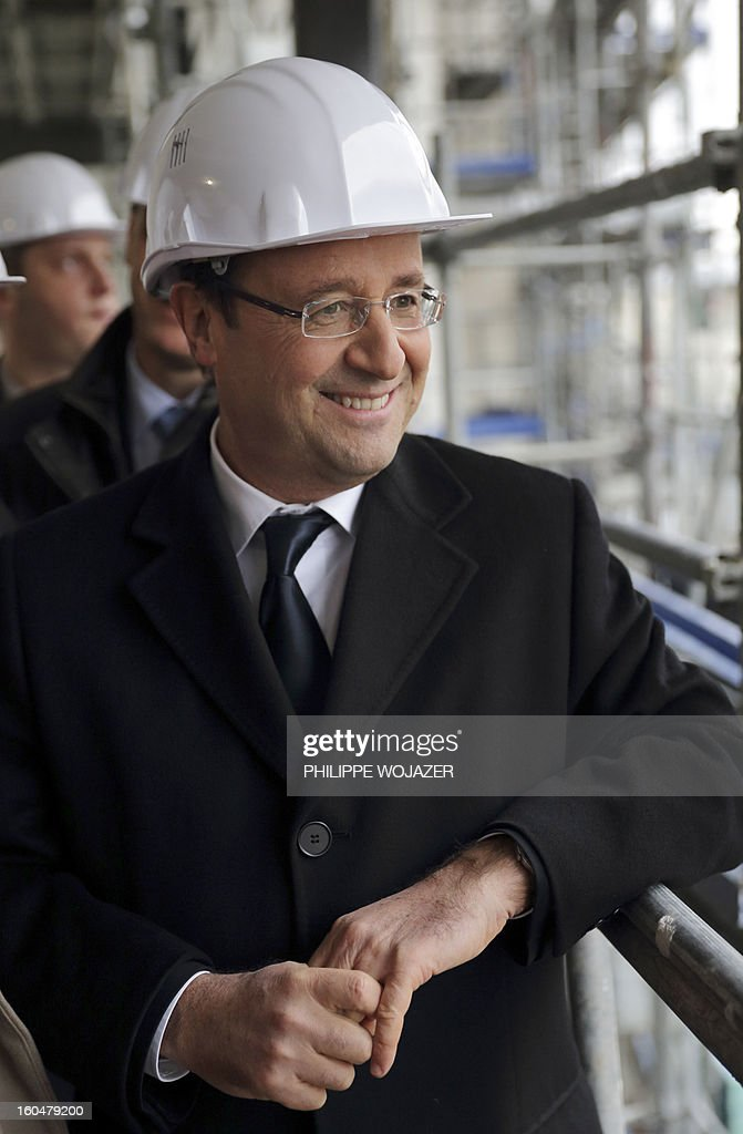 French President Francois Hollande visits housing construction at an urban redevelopment site the urban redevelopment site in Ermont-Eaubonne near Paris on February 1, 2013. POOL