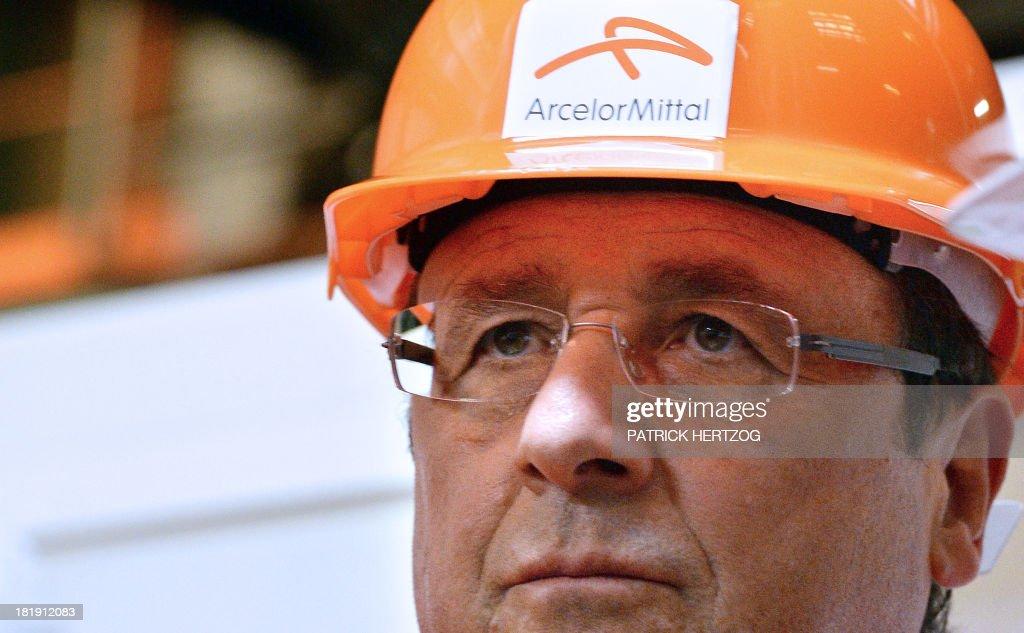 French President Francois Hollande visits the ArcelorMittal main steel factory on September 26 2013 in Florange eastern France AFP PHOTO / POOL /...
