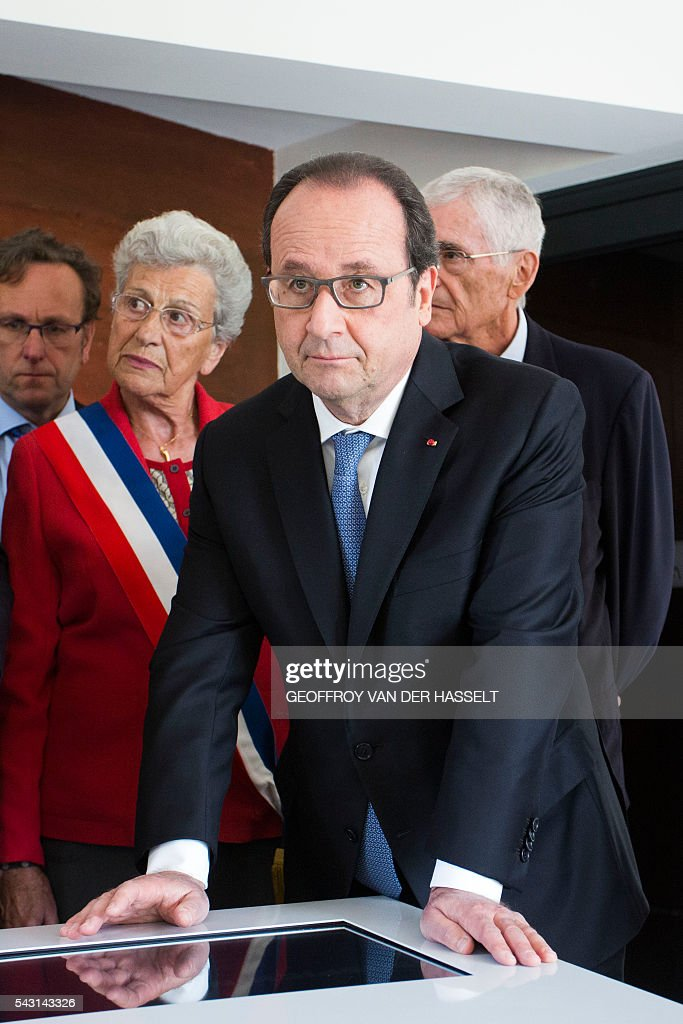 French President Francois Hollande (R) visits the Memorial with Lucienne Biardoux, Mayor of Dun-les-Places (L), during the inauguration ceremony of the memorial of Dun-les-Places in tribute of the victims killed during the Second World War in Dun-les-Places on June 26, 2016. / AFP / GEOFFROY