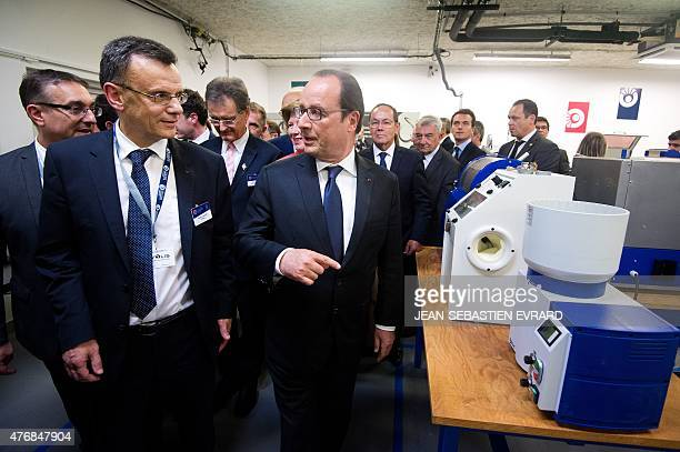 French President Francois Hollande visits the newly inaugurated 'Cite de l'Objet Connecte' with Thierry Sachot President of the 'Cite de l'Objet...