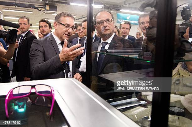 French President Francois Hollande visits the newly inaugurated 'Cite de l'Objet Connecte' in SaintSylvaind'Anjoy near Angers western France on June...