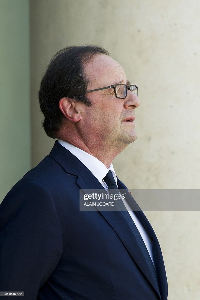 French president Francois Hollande waits for a guest at the Elysee presidential palace on July 3, 2014 in Paris.
