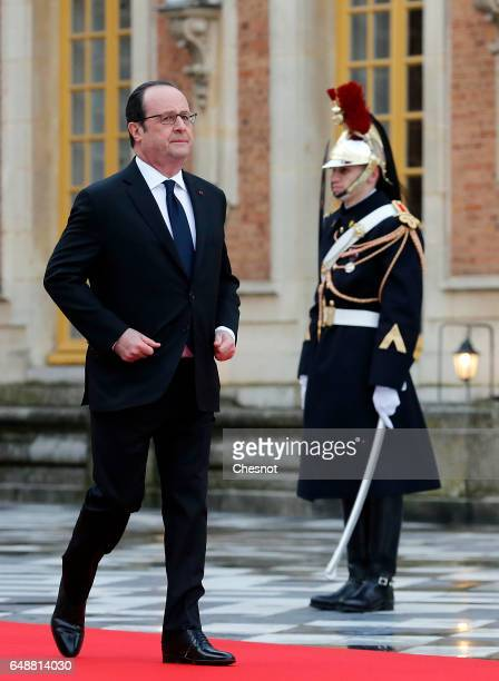 French President Francois Hollande waits for guests during arrivals for a quadripartite summit gathering heads of state and governments from France...