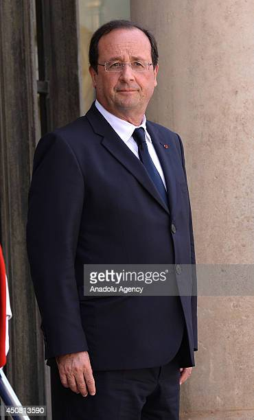French President Francois Hollande waits for Saudi Arabian Prince Meteb bin Abdullah bin Abdulaziz Minister of the National Guard prior to their...