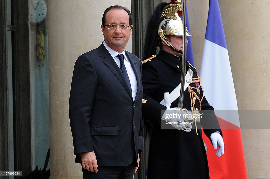 French President Francois Hollande waits for the arrival of Prince Albert II of Monaco at Elysee Palace on December 7, 2012 in Paris, France.