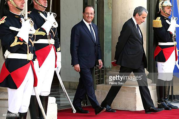 French President Francois Hollande waits for the arrival of Sheikh Tamim Bin Hamad AlThani Emir of Qatar at Elysee Palace on June 23 2014 in Paris...