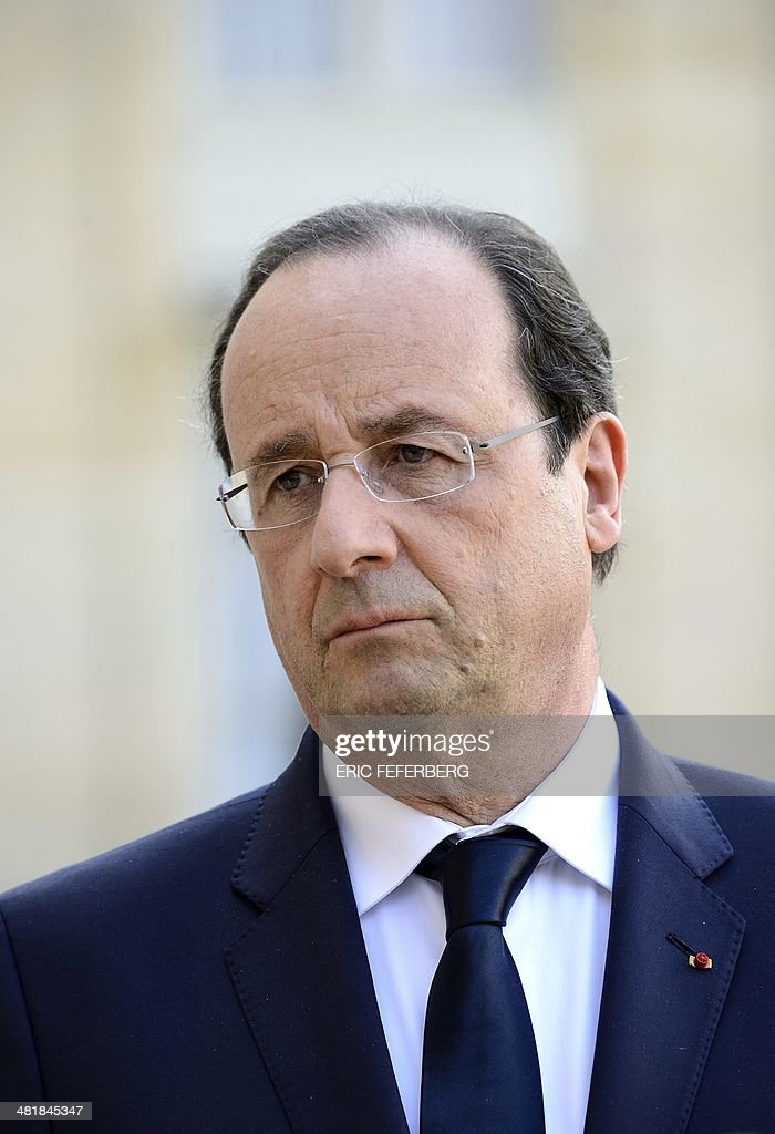French President Francois Hollande waits for the Central African Republic President on April 1, 2014, before a working meeting at the Elysee presidential palace in Paris. The UN's refugee agency said today it was prepared to help evacuate some 19,000 Muslims at risk of attack from mainly Christian militias in the conflict-torn Central African Republic.