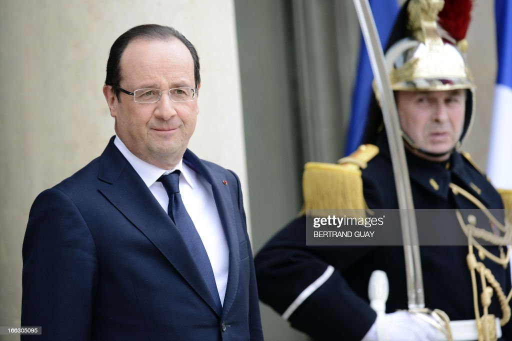 French President Francois Hollande waits for the Ivorian President prior to a meeting at the Elysee Palace in Paris, on April 11, 2013.