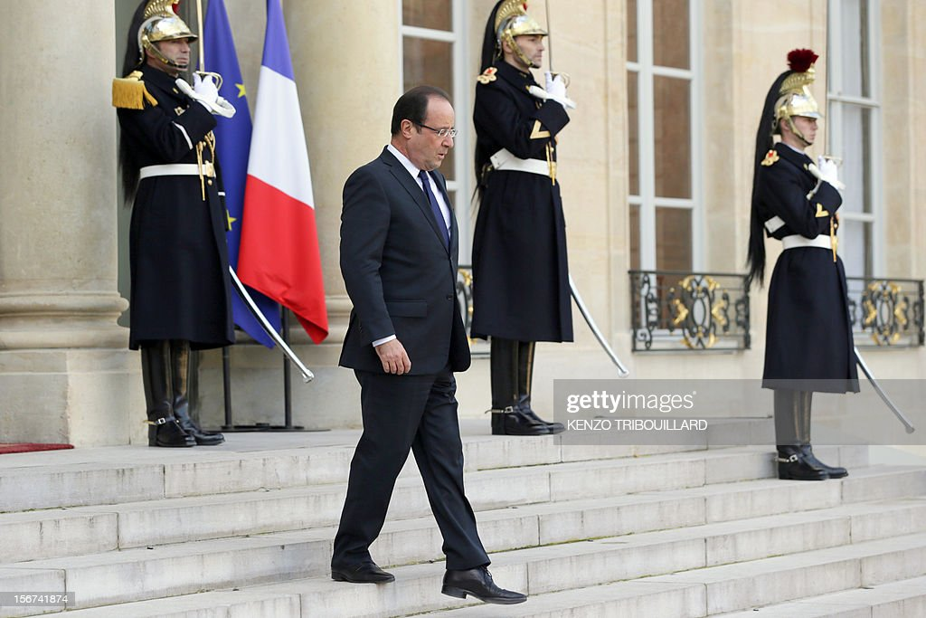 French President Francois Hollande waits Mauritanian President Mohamed Ould Abdel Aziz before a meeting at the Elysee Palace in Paris, on November 20, 2012. Aziz said he would soon return to Mauritania from France, where he is recovering after being shot by a soldier in his country on October 13.