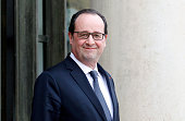 French President Francois Hollande waits prior a meeting with Francophonie GeneralSecretary Michaelle at the Elysee Palace on February 18 2015 in...
