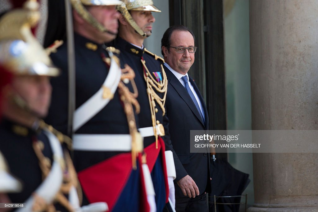 French President Francois Hollande waits prior to a meeting with French leaders of political parties and movements after Britain voted to leave the European Union the day before, on June 25, 2016 at the Elysee presidential Palace in Paris. As the 'Brexit' vote sent global financial markets into freefall, Moody's cut Britain's credit rating outlook to 'negative', saying the vote to pull out of the European Union could hurt its economic prospects. / AFP / GEOFFROY