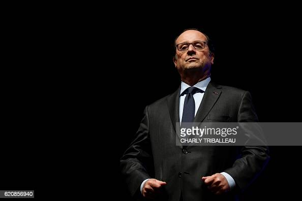 TOPSHOT French President Francois Hollande waits prior to deliver a speech as part of the symposium 'Caen 19562016 La Recherche construire demain' at...