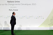 French president Francois Hollande waits prior to the arrivals for the opening of the UN conference on climate change on November 30 2015 at Le...