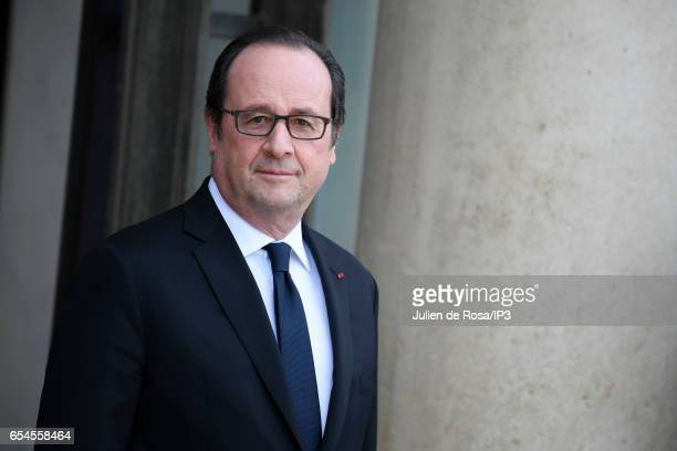 French President Francois Hollande waits the arrival of Catherine Duchess of Cambridge and her husband Prince William Duke of Cambridge for a meeting...