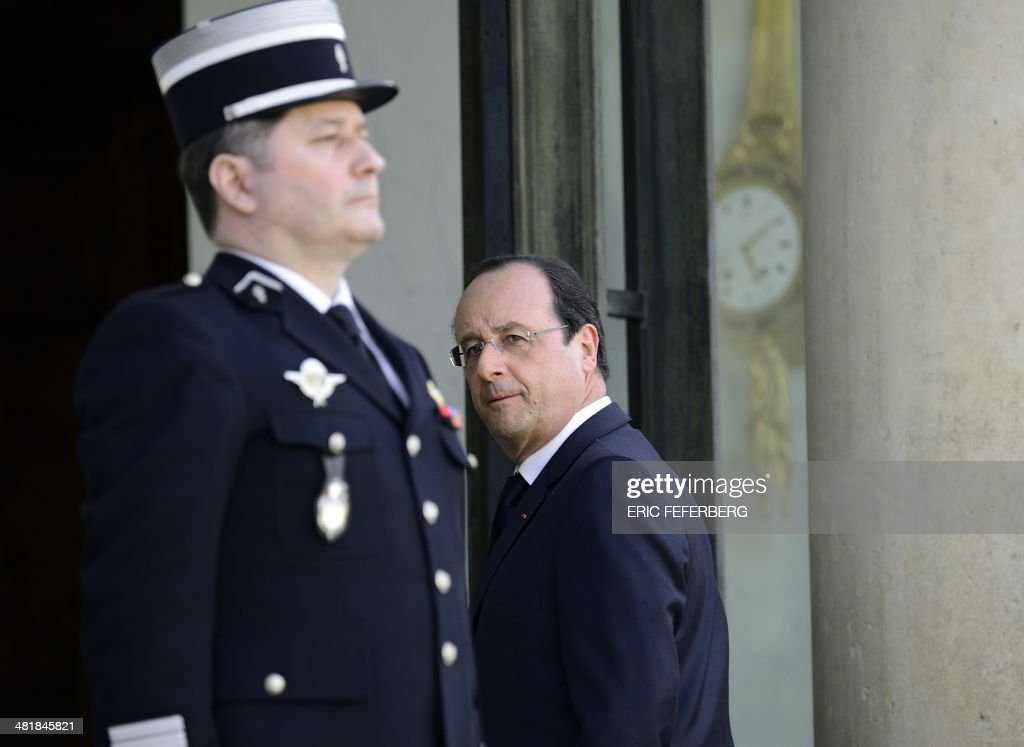 French President Francois Hollande walks back into the Elysee presidential palace in Paris, on April 1, 2014, after a meeting with the Central African President. The UN's refugee agency said today it was prepared to help evacuate some 19,000 Muslims at risk of attack from mainly Christian militias in the conflict-torn Central African Republic.