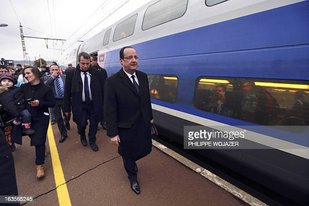 French President Francois Hollande walks on March 12 2013 on the platform to take a highspeed TGV train from Montbard to Paris AFP PHOTO / POOL /...