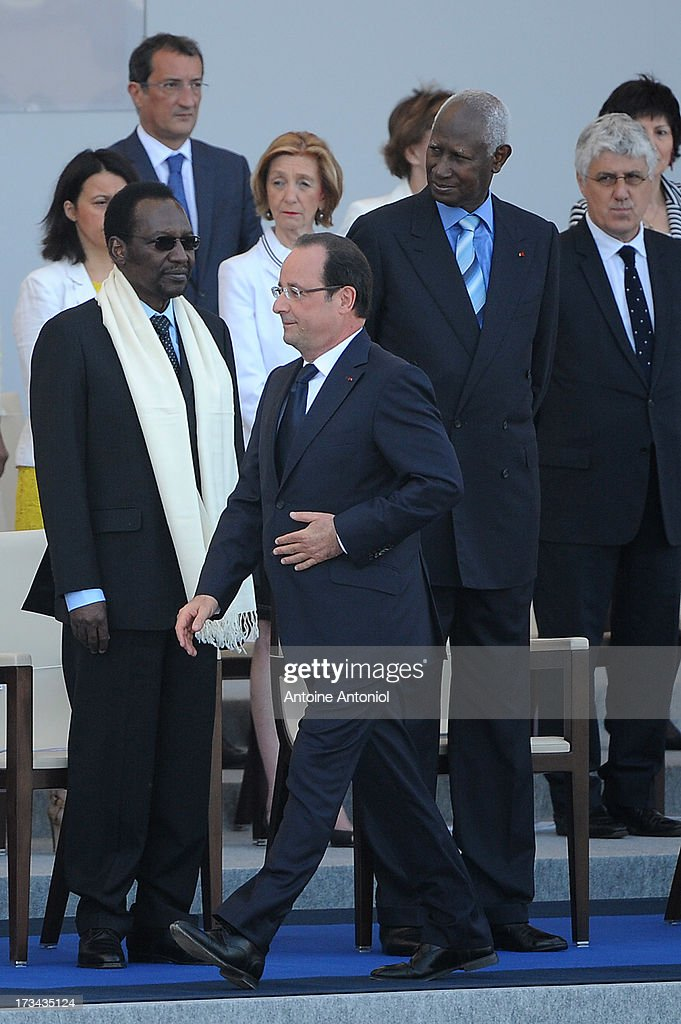 French President Francois Hollande walks past Malian President <a gi-track='captionPersonalityLinkClicked' href=/galleries/search?phrase=Dioncounda+Traore&family=editorial&specificpeople=9117926 ng-click='$event.stopPropagation()'>Dioncounda Traore</a> during the Bastille Day parade on the Champs Elysees on July 14, 2013 in Paris, France. The annual military ceremony is the largest in Europe remembering the 'Fete de la Federation' for 1790.
