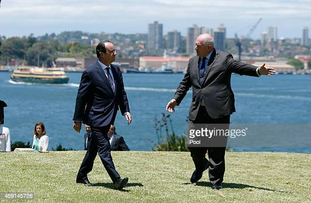 French President Francois Hollande walks with Australia's GovernorGeneral Peter Cosgrove during Hollande's visit to Admiralty House for an official...