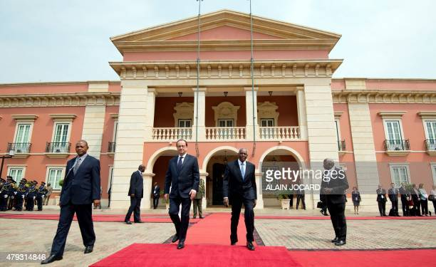 French president Francois Hollande walks with his Angolan counterpart Jose Eduardo Dos Santos at the Presidential Palace in Luanda on July 3 2015...