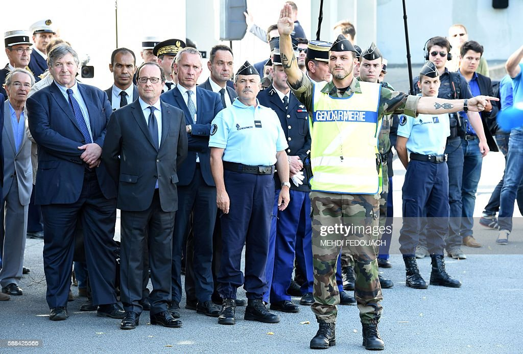 French President Francois Hollande watches an exercise of reservists as he visits the French Gendarmerie school in Tulle central France on August 11...