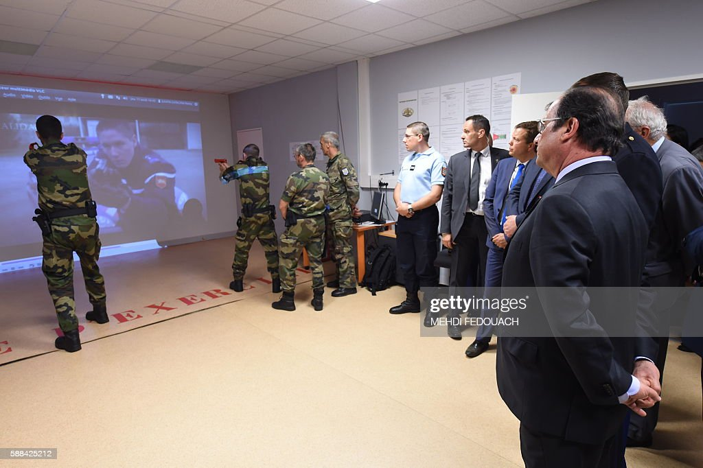 French President Francois Hollande watches reservists during an exercise as he visits the French Gendarmerie school in Tulle central France on August...