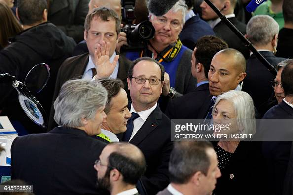 TOPSHOT French President Francois Hollande waves as he visit of the International Agriculture Fair on its opening day at the Porte de Versailles...