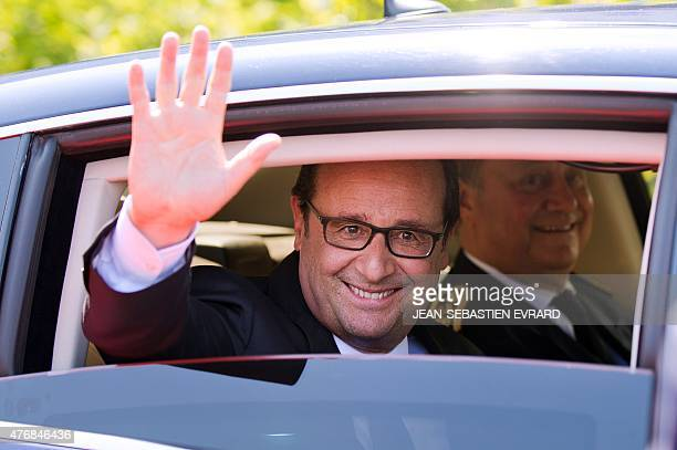 French President Francois Hollande waves from a car after the inauguration of the 'Cite de l'Objet Connecte' in SaintSylvaind'Anjoy near Angers...